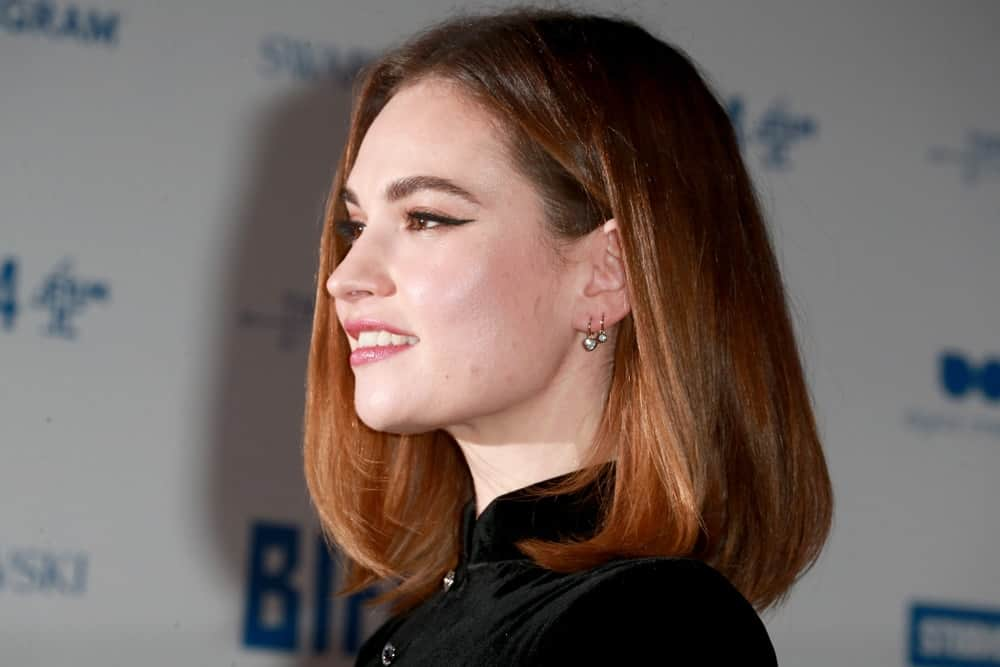 On December 1 2019, Lily James was at the 22nd British Independent Film Awards in London. She wore a black outfit with her auburn shoulder-length bob hairstyle with subtle layers.