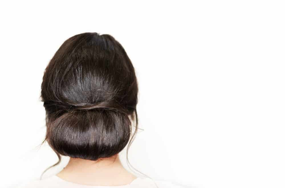 Woman with low bun hairstyle