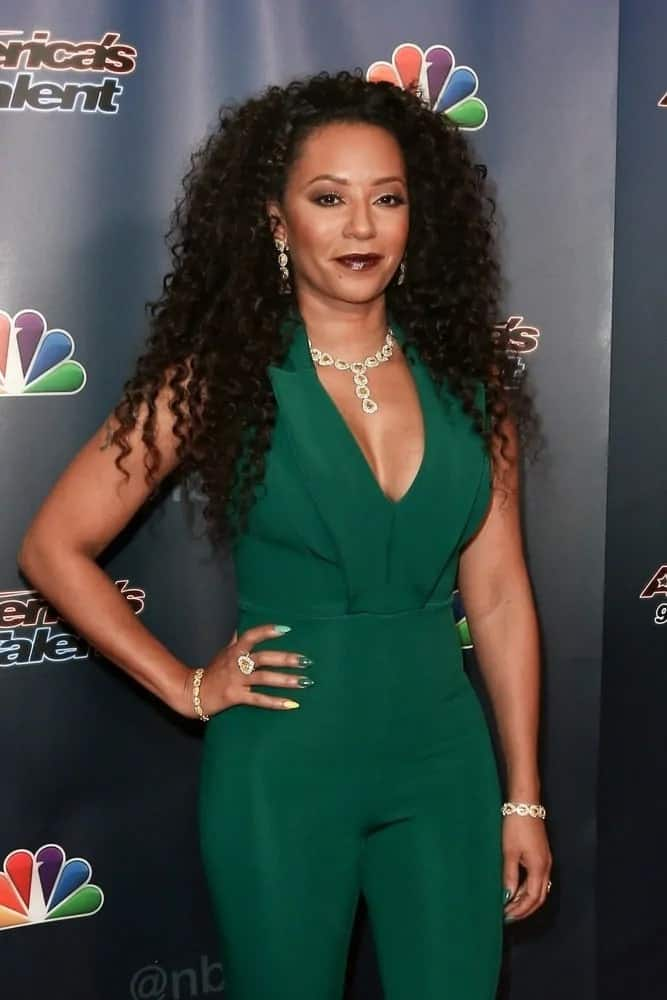 Mel B looks sensational in a teal jumpsuit as she wears her naturally kinky strands loose, completely complementing her red carpet looks at America's Got Talent Season 10 Semi-finals taping on September 9, 2015.