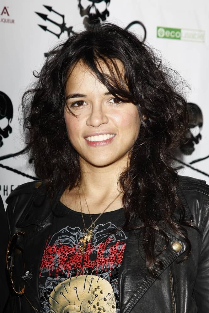 Michelle Rodriguez rocks a tousled curly hairstyle with side bangs during the Animal Planet's 'Whale Wars' + Sea Shepherd Conservation Society event for 'Operation No Compromise' on October 23, 2010.