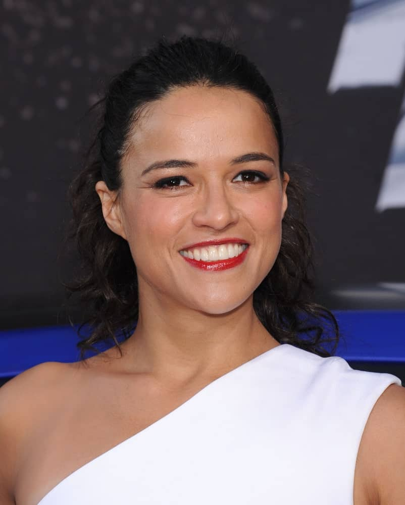 Michelle Rodriguez gathered her shoulder-length curls in a slicked back half updo during the