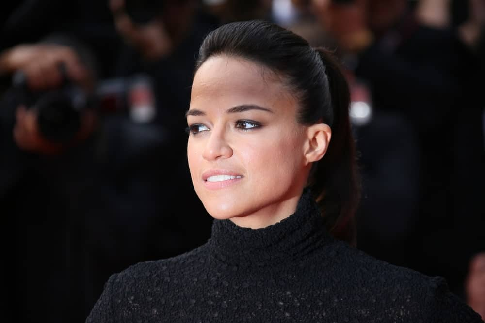 On May 24, 2015, Michelle Rodriguez was seen at the closing ceremony and 'Le Glace Et Le Ciel' Premiere during the 68th annual Cannes Film Festival. She was wearing an all-black dress that's matched with a neat ponytail hairstyle.