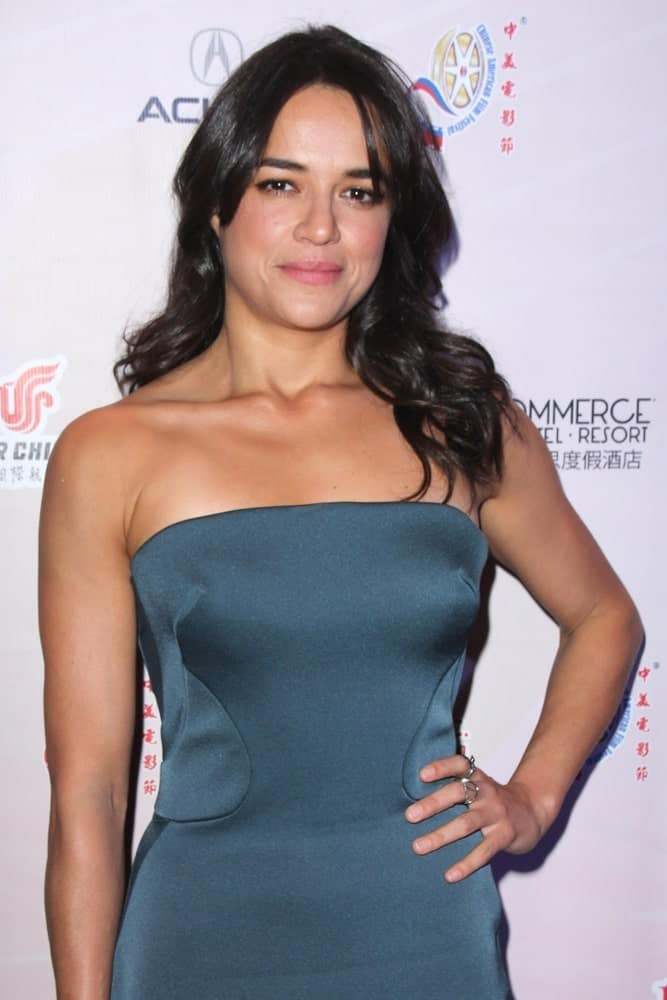 Michelle Rodriguez is a green Goddess in her emerald green silky strapless gown along her long brunette tresses styled in soft loose curls with curtain bangs as she attends the 11th Annual Chinese American Film Festival Opening Night on November 2, 2015.