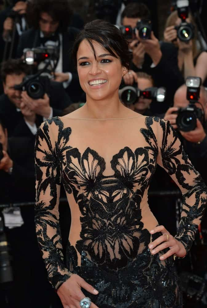 Michelle Rodriguez glam up in a semi-sheer floor-length gown and herdark tresses were swept back in a neat bun as she attends the gala premiere of