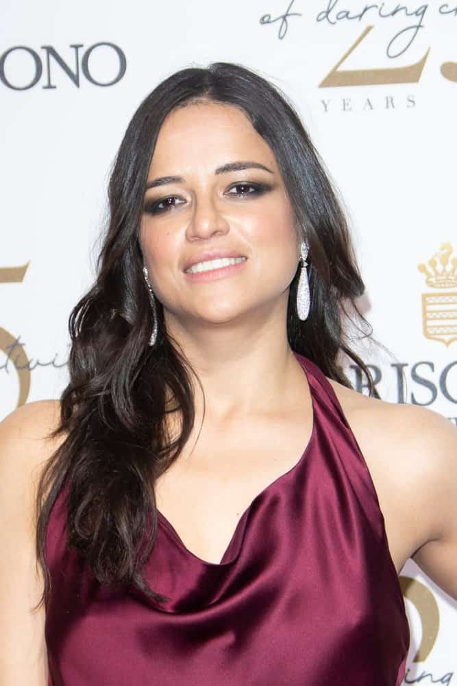 Michelle Rodriguez overflowed with posh and class in a silky dress paired with her loose waves that are center-parted at the De Grisogono Party during the 71st annual Cannes Film Festival on May 15, 2018.