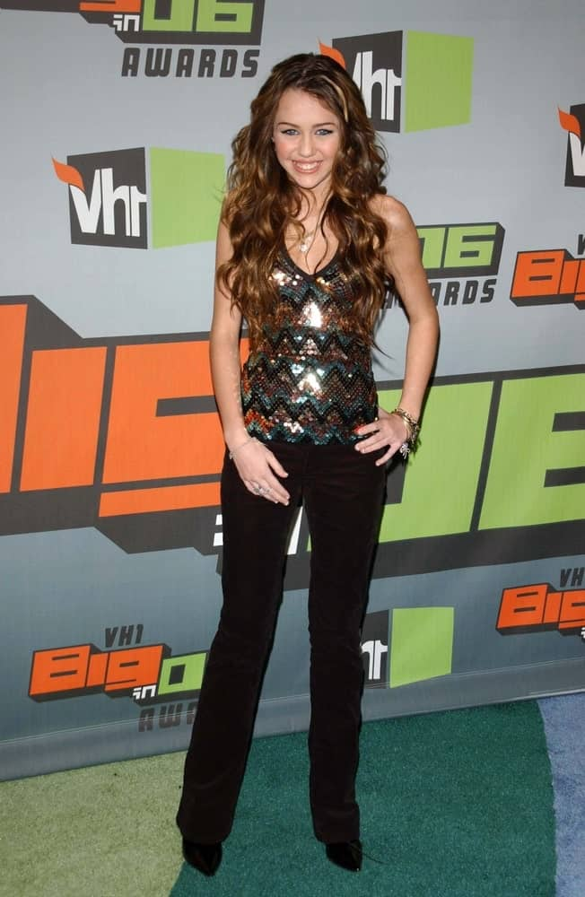 Miley Cyrus was all smiled in her glittery blouse and long wavy layered hairstyle with highlights at the VH1 Big in '06 Awards on December 02, 2006 at Sony Studios, Culver City, CA.