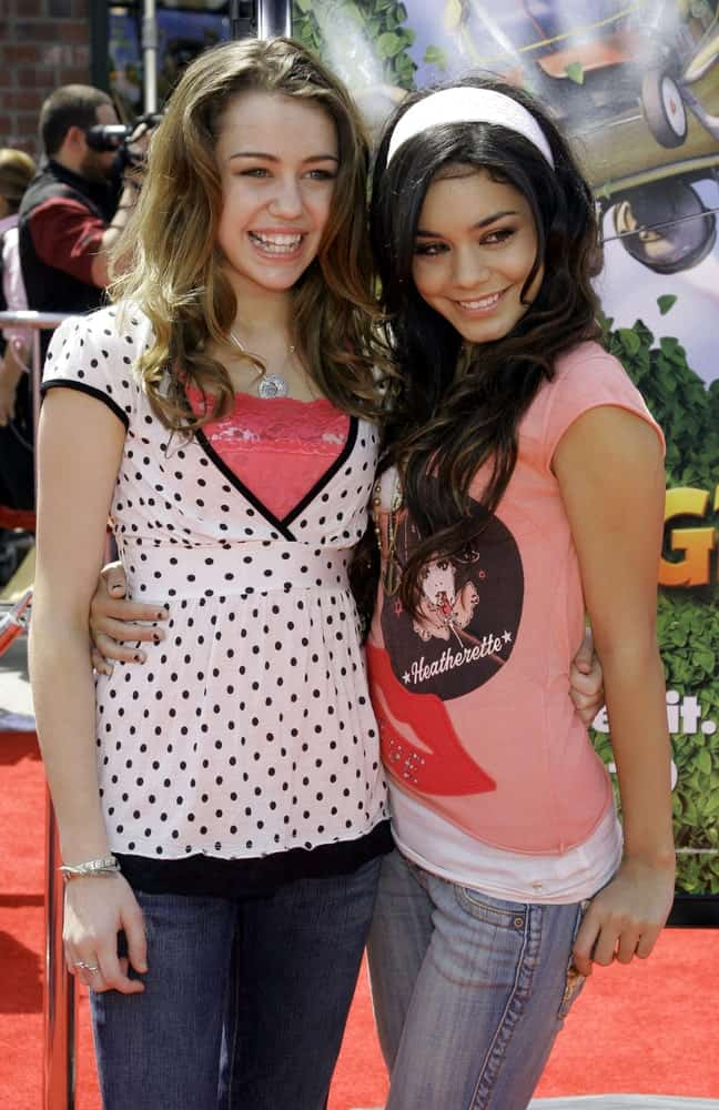 A young Miley Cyrus and Vanessa Hudgens were at the Los Angeles premiere of 'Over The Hedge' held at the Mann Village Theatre in Westwood on April 30, 2006. Cyrus wore a simple casual outfit with her wavy highlighted dark brown hair.