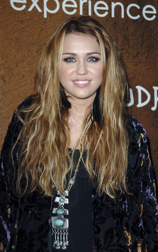Miley Cyrus went with a loose and tousled wavy sandy blond hairstyle to go with her casual outfit at the Grand Opening of XANDROS Greek Restaurant, 50 North La Cienega in Beverly Hills, CA on October 7, 2010.