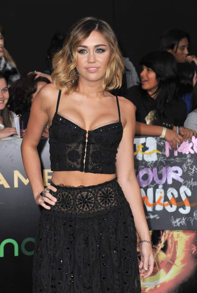 Miley Cyrus went with a sexy hippie look with her two-piece black outfit and stunning highlighted wavy hairstyle at the world premiere of