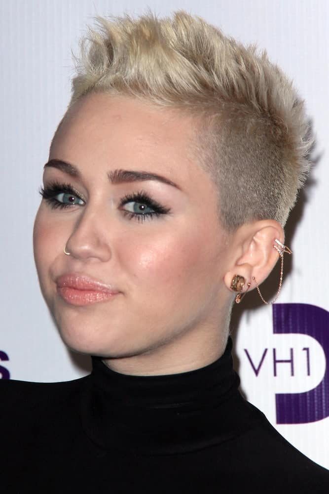 Miley Cyrus wowed everyone with her sexy tight black dress and spiked platinum blond hairstyle at the VH1 Divas Concert 2012 at Shrine Auditorium on December 16, 2012 in Los Angeles, CA.