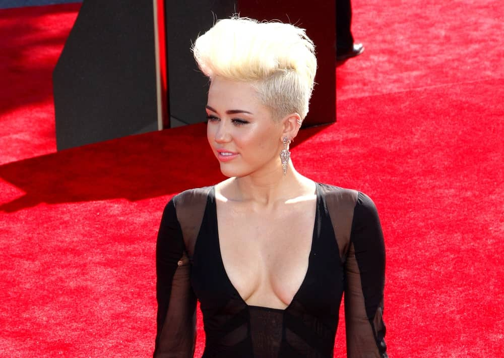 Miley Cyrus was quite iconic with her gorgeous sexy dress and platinum blond undercut swept up into a tall pompadour hairstyle at the 2012 MTV Video Music Awards held at the Staples Center in Los Angeles, United States on September 6, 2012.