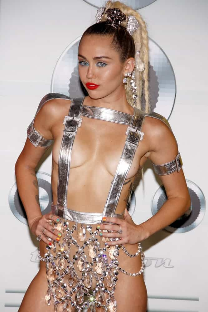 Miley Cyrus channelled her inner burlesque with this jewelled and silver outfit that she paired with a high ponytail with long blond braids at the 2015 MTV Video Music Awards held at the Microsoft Theater in Los Angeles on August 30, 2015.