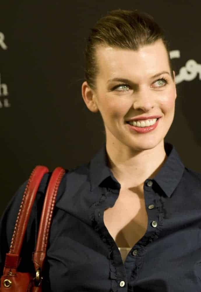 Milla Jovovich was at the presentation of the new Tommy Hilfiger complements collection on March 18, 2010, in Madrid. She was lovely in a dark outfit to pair with her slicked-back neat hairstyle and simple makeup.