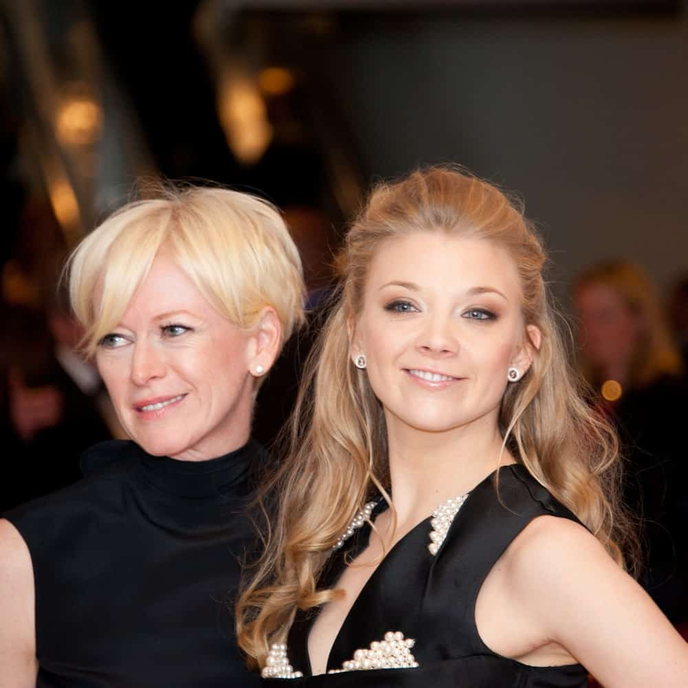 Natalie Dormer with Joanna Coals at the White House Correspondents Dinner on April 27, 2013. Natalie sported a tousled slicked half updo paired with a black embellished dress.