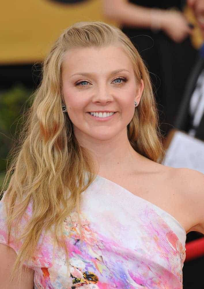 Natalie Dormer looked ethereal wearing this tousled wavy hairstyle with pinned up bangs at the 2015 Screen Actors Guild Awards on January 25, 2015.