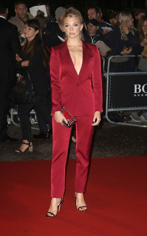 Natalie Dormer went for a high ponytail with a pouf that she paired with a matching red velvet suit and pants during the GQ Men of the Year Awards held at the Tate Modern in London on September 5, 2017.
