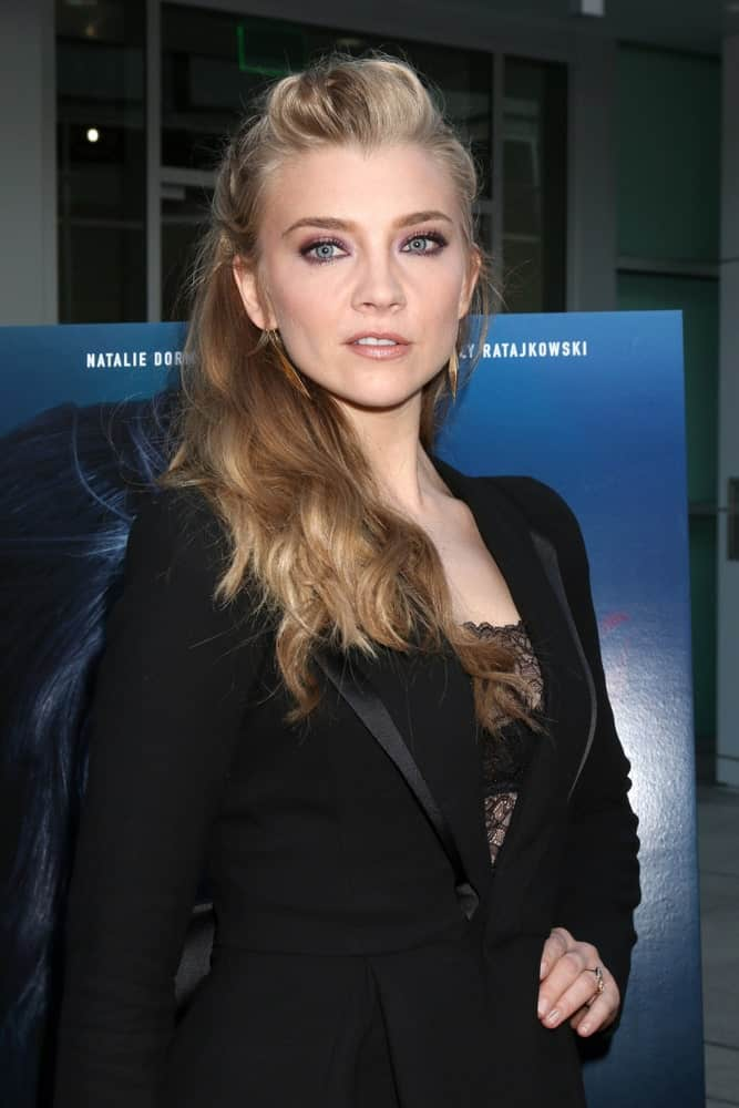 Natalie Dormer pulled off a sharp look with her highlighted blonde waves styled in a sleek half updo during the