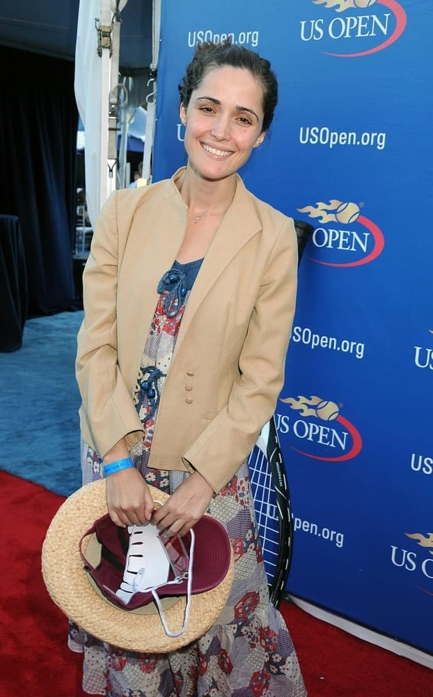 Rose Byrne was in attendance for Sun - US OPEN Tennis Tournament at the USTA Billie Jean King National Tennis Center in Flushing, NY on September 07, 2008. She wore a lovely sundress that she paired with her messy dark bun hairstyle.