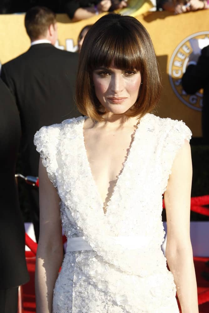 Rose Byrne was at the 18th annual Screen Actor Guild Awards at the Shrine Auditorium on January 29, 2012 in Los Angeles, California. She was stunning in a white dress that paired well with her chin-length straight bob hairstyle with blunt bangs and highlights.