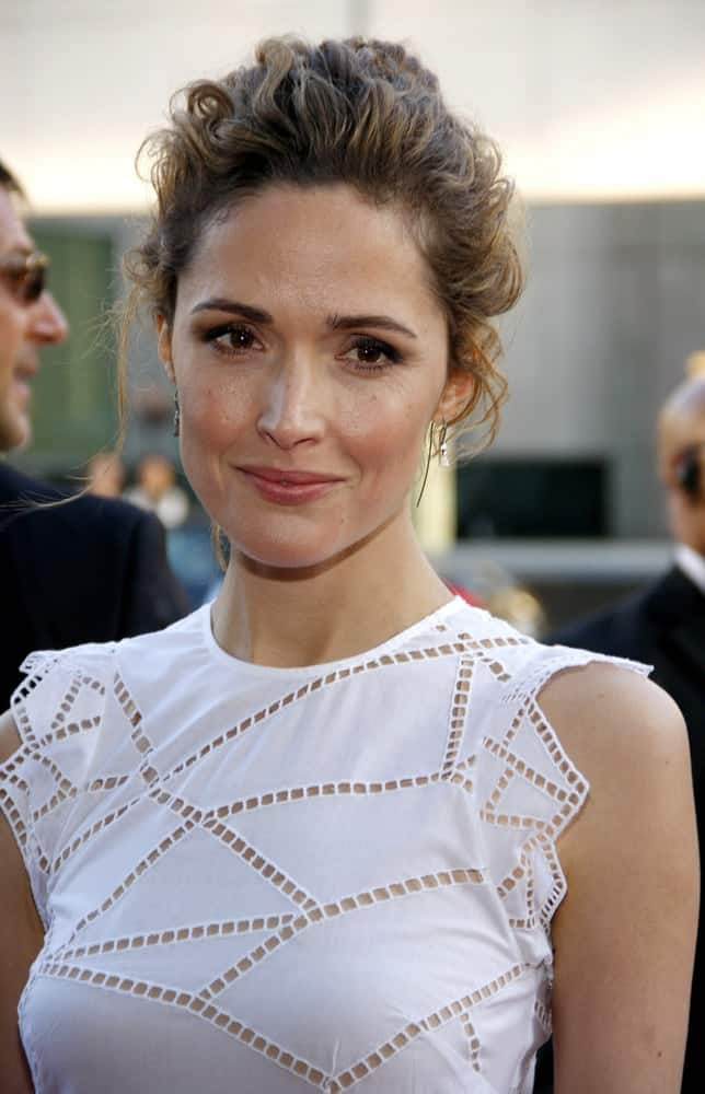 On July 24, 2013, Rose Byrne attended the Los Angeles premiere of 'Blue Jasmine' held at the AMPAS Samuel Goldwyn Theater in Beverly Hills, Los Angeles. She was seen wearing a white dress with her messy upstyle bun hairstyle.
