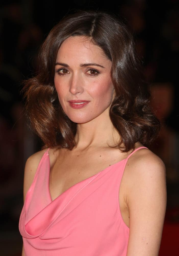 Rose Byrne attended the 'I Give It A Year' premiere, at the Vue Leicester Square, London on January 24, 2013. SHe was seen wearing a lovely pink dress to pair with her dark wavy shoulder-length bob hairstyle with layers.