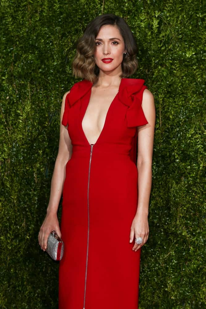 Actress Rose Byrne attended the American Theatre Wing's 69th Annual Tony Awards at Radio City Music Hall on June 7, 2015 in New York City. She was stunning in a red dress, red lipstick and shoulder-length wavy bob hairstyle with highlights.