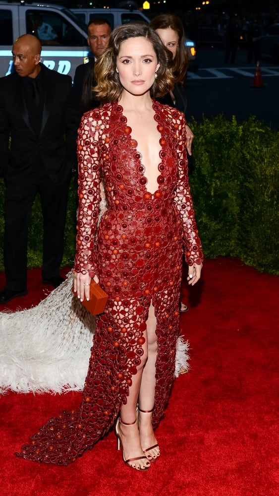 On May 04, 2015, Rose Byrne attended the 'China: Through The Looking Glass' Costume Institute Gala, held at the Metropolitan Museum of Art in New York City, New York. She wore a sexy red dress that [aired well with her tousled and wavy chin-length bob hairstyle with highlights.