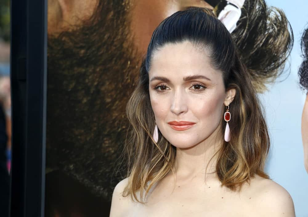 Rose Byrne was at the Los Angeles premiere of 'Neighbors 2: Sorority Rising' held at the Regency Village Theatre in Westwood on May 16, 2016. She wore a strapless dress and topped it with a half-up slick and highlighted hairstyle.