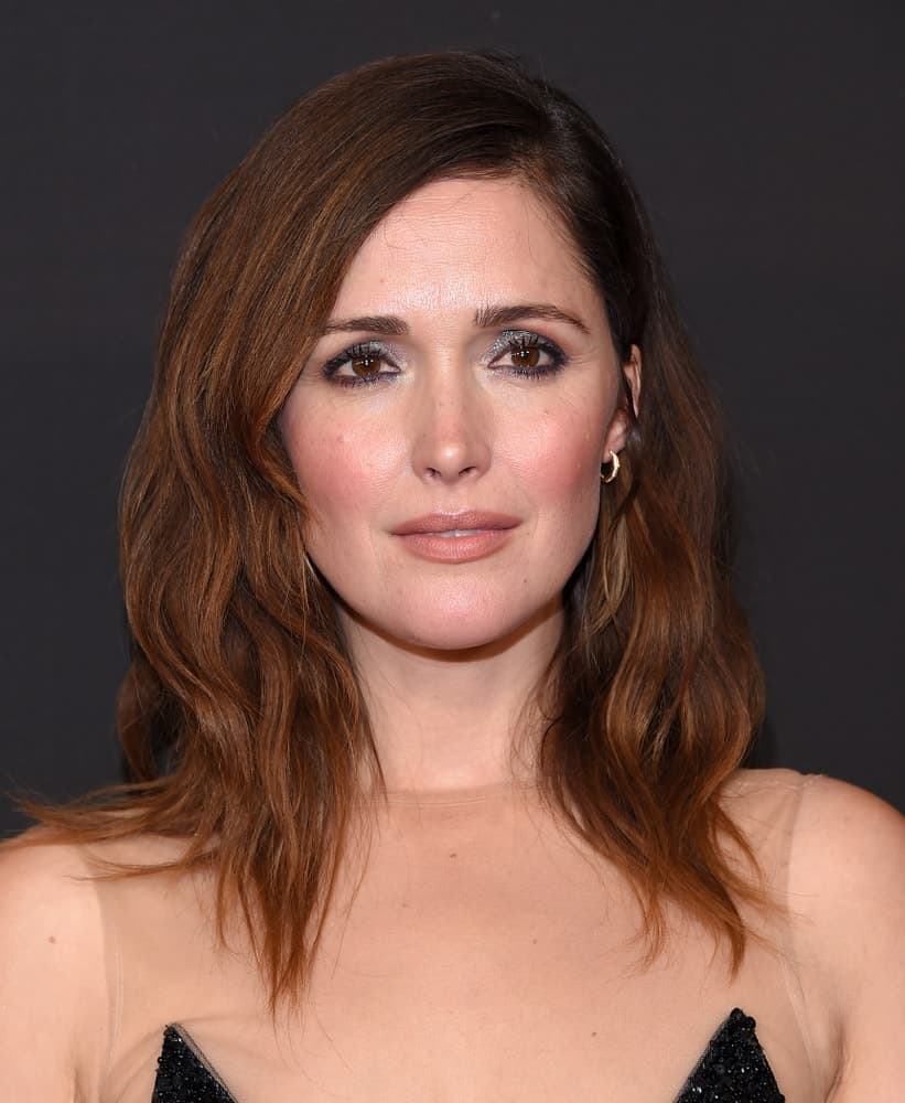 Rose Byrne attended the G'Day USA Gala 2018 on January 27, 2018 in Los Angeles, CA. She was seen wearing a sheer dress with her shoulder-length tousled and layered brunette hairstyle with side-swept bangs.