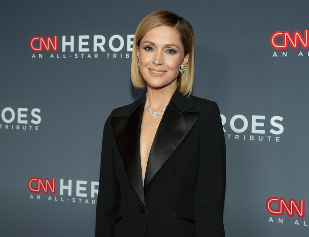 On December 8, 2019, Rose Byrne wore an outfit by Armani when she attended the 13th Annual CNN Heroes at the American Museum of Natural History. She paired this with a chin-length sandy blonde straight bob hairstyle.