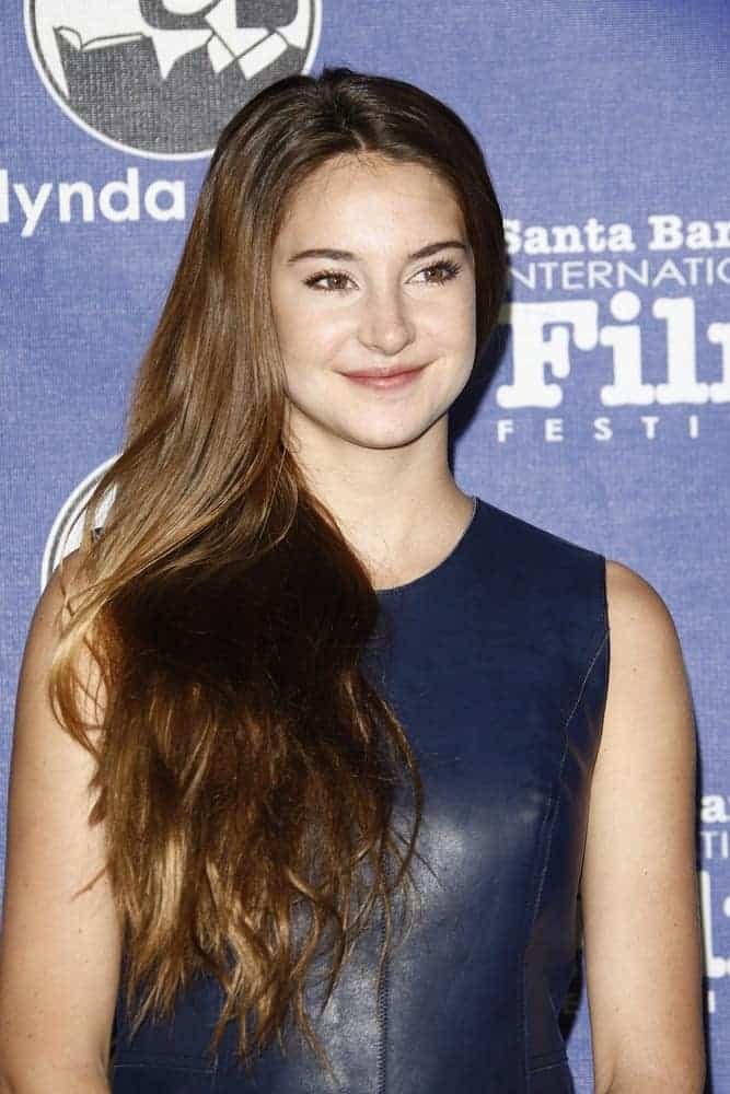 Shailene Woodley was at the 27th annual Santa Barbara Film Festival Virtuosos Award Ceremony at the Arlington Theater on February 3, 2012, in Santa Barbara, California. She was seen wearing a navy blue leather dress to pair with her side-swept long highlighted brunette hairstyle with layers.