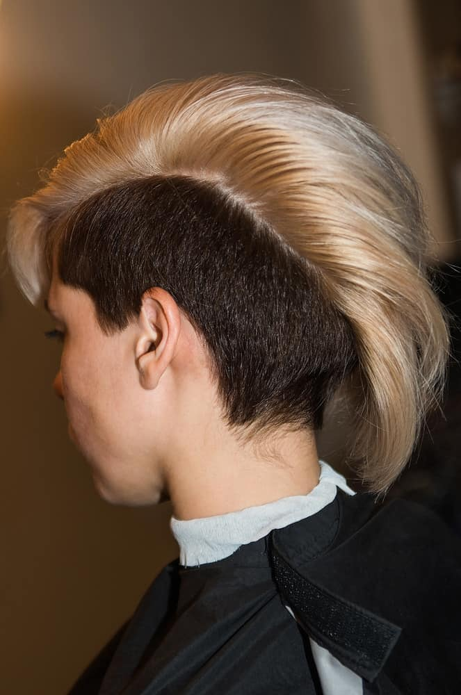Woman with short sides haircut