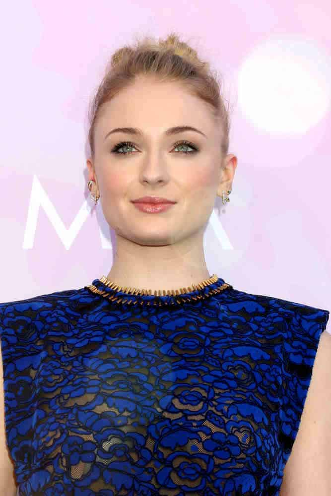 Sophie Turner stylishly slicked back her hair in a high bun style at the Variety's Celebratory Brunch Event For Awards Nominees on January 28, 2017.