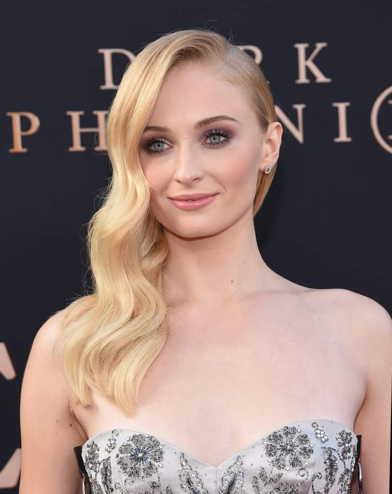 Sophie Turner flaunted her soft wavy blonde hair swept to one side during the 'Dark Phoenix' Global Premiere on June 04, 2019 in Hollywood, CA.