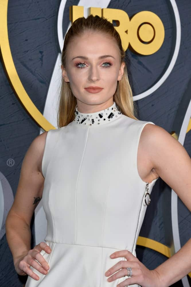Sophie Turner struck a pose while sporting her slick half upstyle during the HBO post-Emmy Party at the Pacific Design Centre held on September 23, 2019.