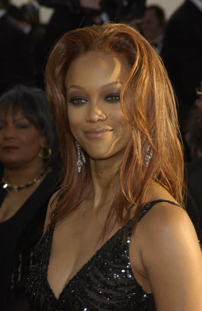 Tyra Banks attended the 61st Annual Golden Globe Awards at the Beverly Hilton Hotel in Beverly Hills, CA on January 25, 2004. She wore a sexy black dress that went great with her reddish brown loose and tousled layers.