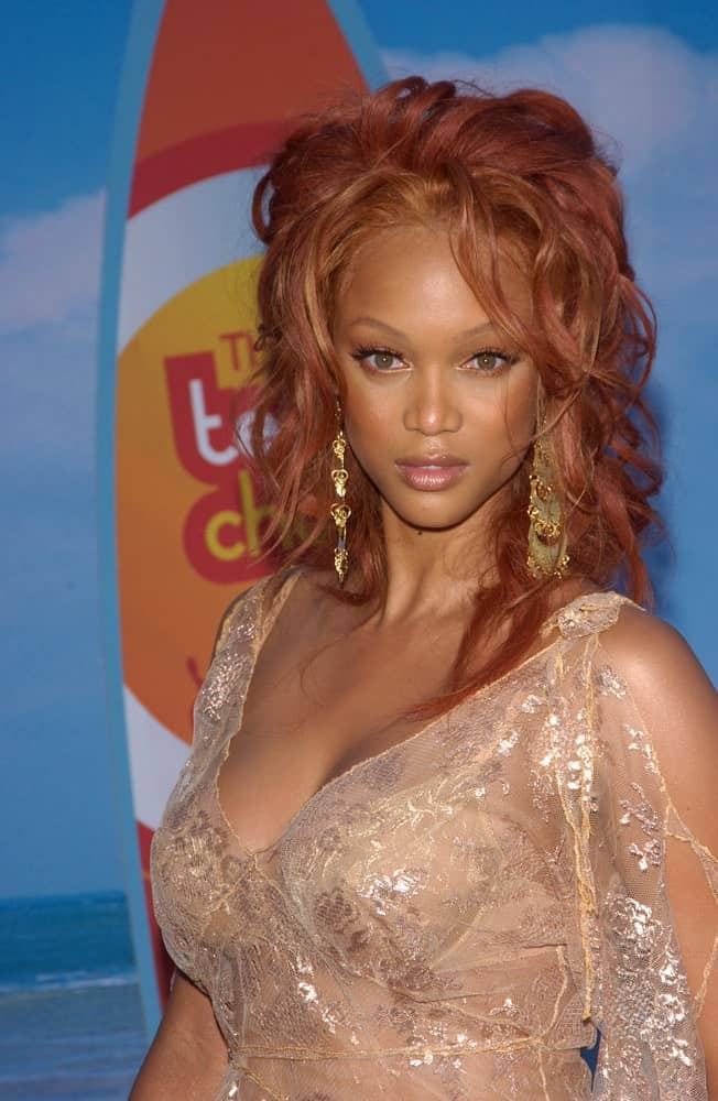 Tyra Banks' hair was dyed red and tousled with waves to go with her sheer dress at the 2004 Teen Choice Awards at Universal Studios in Hollywood on August 8, 2004.