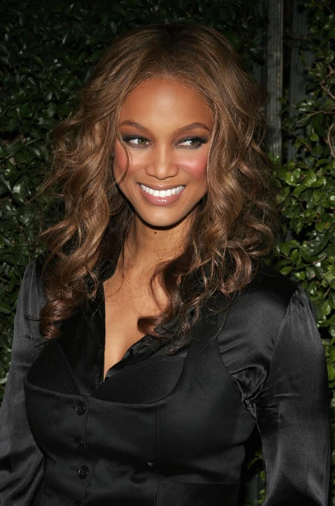 Tyra Banks' caramel-toned hairstyle was long and curly that complements her black satin blouse at the Los Angeles premiere of 'The Producers' held at the Westfield Century City in Century City on December 12, 2005.