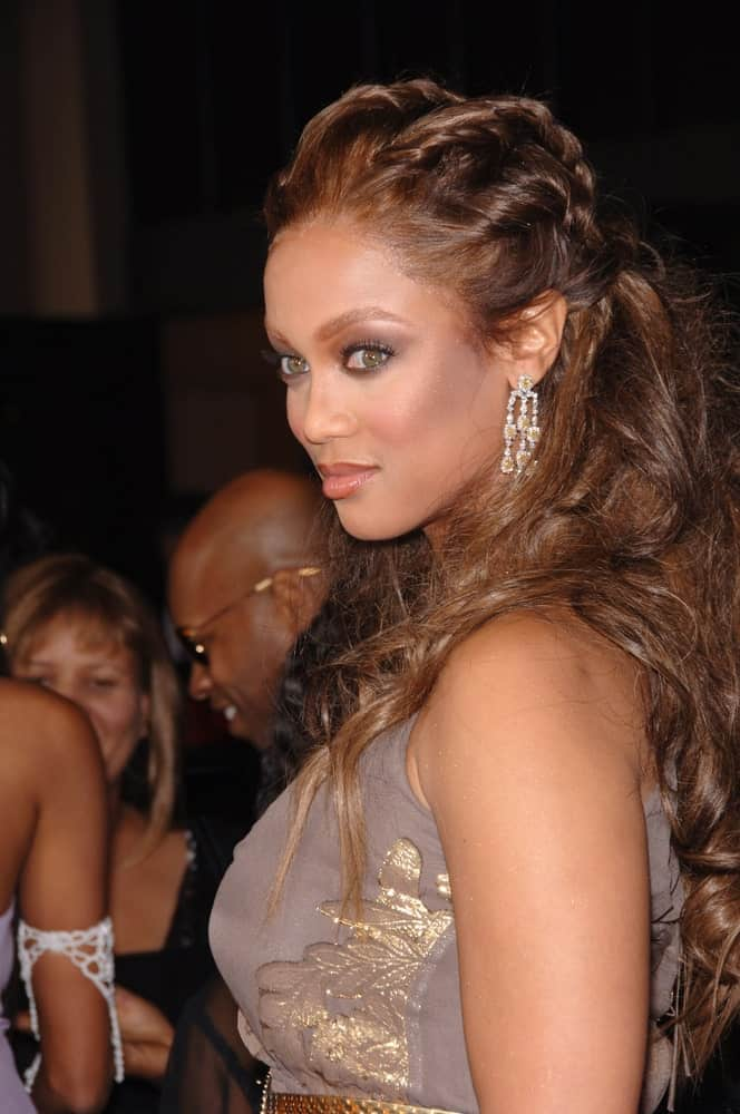 Tyra Banks was at the 37th Annual NAACP Image Awards at the Shrine Auditorium, Los Angeles on February 25, 2006. SHe wore a gray detailed dress that she paired with a half-up hairstyle incorporated with rows of braids.