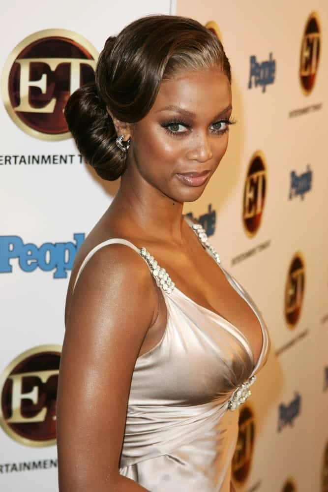 Tyra Banks attended the 10th Annual Entertainment Tonight Emmy Party Sponsored by People in Mondrian on August 27, 2006 in West Hollywood, CA. She had a vintage look to her side-swept low bun hairstyle and pearly white dress.