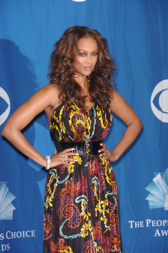 Model Tyra Banks wore a lovely and colorful dress that complemented her center-parted long curly hairstyle at the 2006 People's Choice Awards in Los Angeles on January 10, 2006.