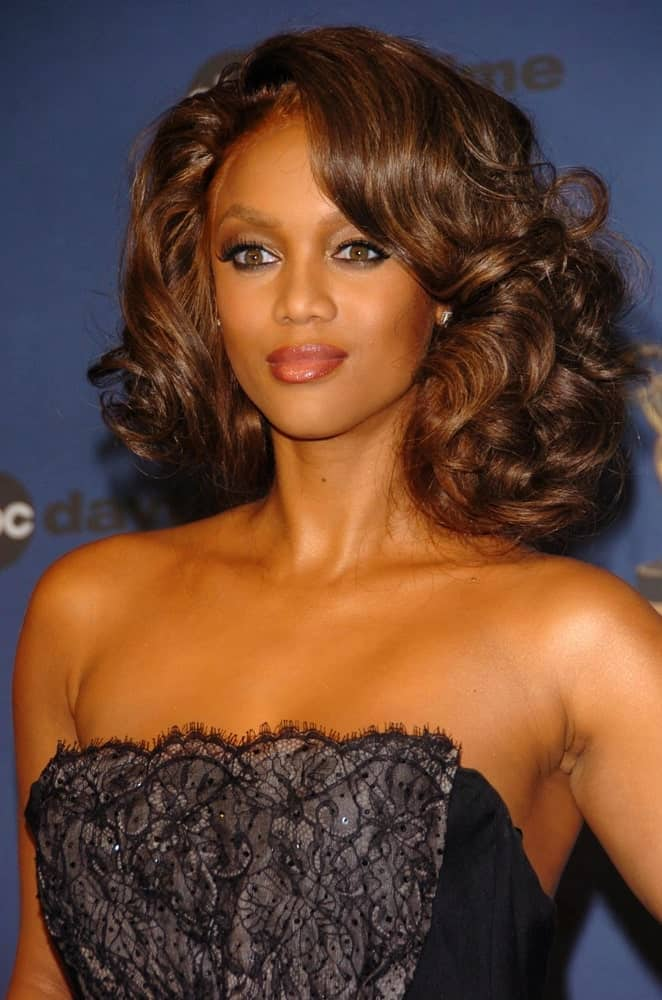 Tyra Banks was quite lovely with her sexy black dress and vintage curly side-swept hairstyle in the press room at The 33rd Annual Daytime Emmy Awards at Kodak Theatre on April 28, 2006 in Hollywood, CA.