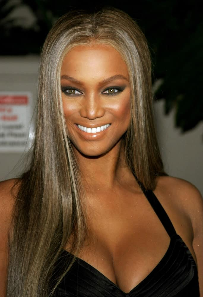 Tyra Banks' long and straight hair has a slight matallic tone to it that went well with her black dress at the Rodeo Drive Walk Of Style Award honoring Gianni and Donatella Versace held at the Beverly Hills City Hall in Beverly Hills, California on February 8, 2007.