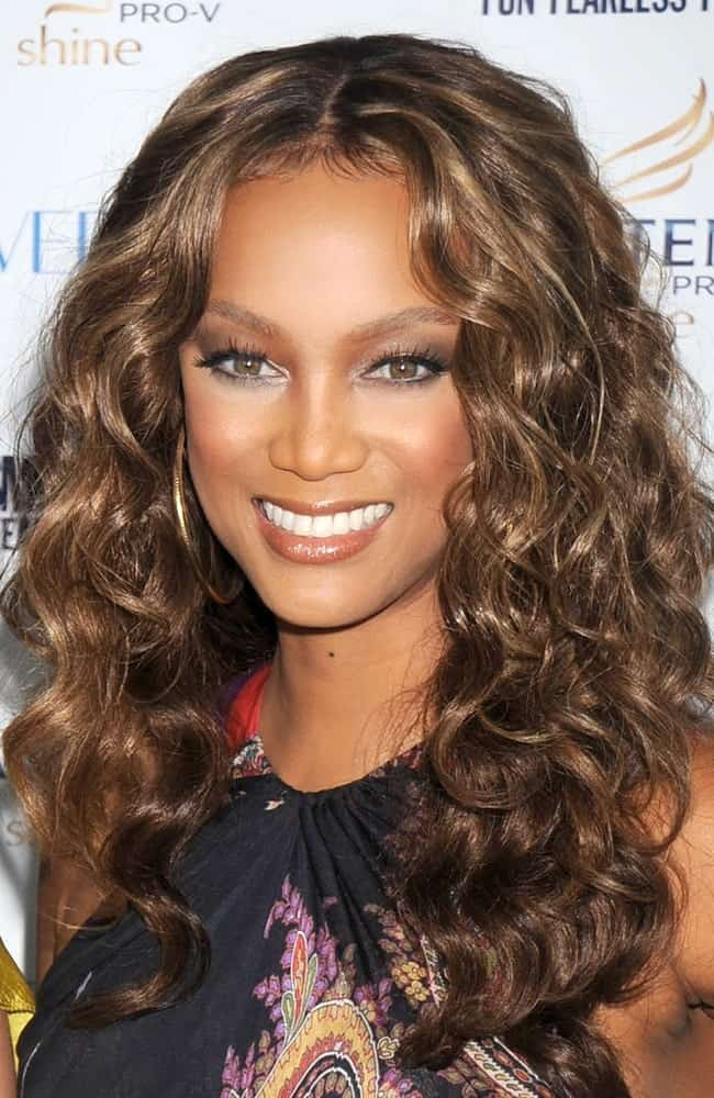 Tyra Banks' medium-lenth curly hair was perfectly tousled and toned to pair with her colorful outfit at the Cosmopolitan's Fun Fearless Phenom Awards, Hearst Tower in New York on September 15, 2008.