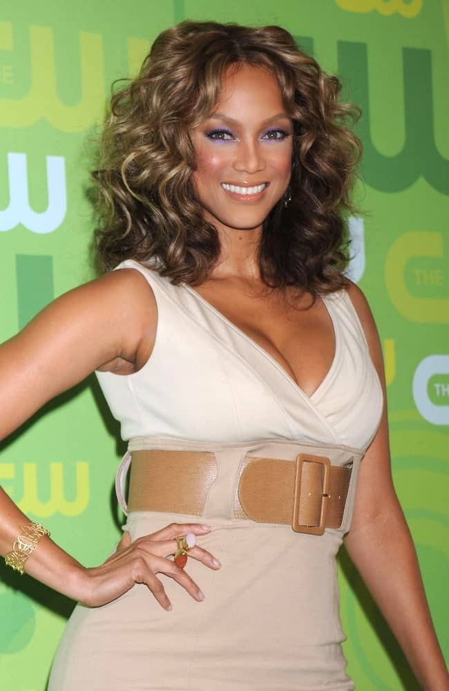 Tyra Banks's gorgeous bright smile pairs perfectly with her colorful makeup and tousled dark brown curls at Part 2 - The CW Network Television Upfronts, Lincoln Center in New York on May 13, 2008.