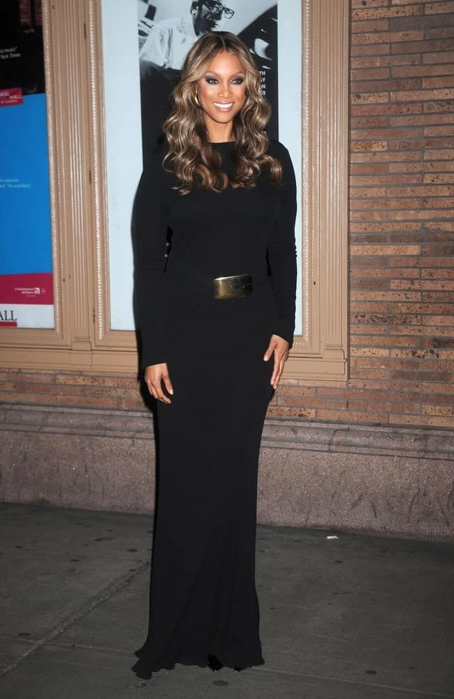 Tyra Banks' long black dress complemented her highlighted long wavy hairstyle that is center-parted at the GLAMOUR Women of the Year Awards 2008 in Carnegie Hall, New York on November 10, 2008.