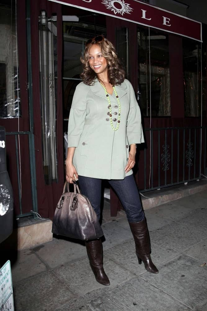 Tyra Banks was seen carrying a Prada bag leaving El Sole Restaurant in Los Angeles on April 24, 2008. She wore casual jeans and jacket to pair with her gorgeous highlighted curly hairstyle.