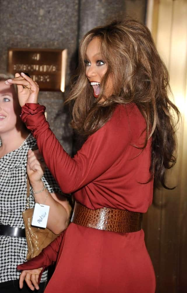 Tyra Banks was bubbly at 5th Annual FASHION ROCKS Concert Hosted by Conde Nast, Radio City Music Hall in New York, NY on September 05, 2008. She wore a red dress with a belt to go with her long, wavy and tousled loose hairstyle.