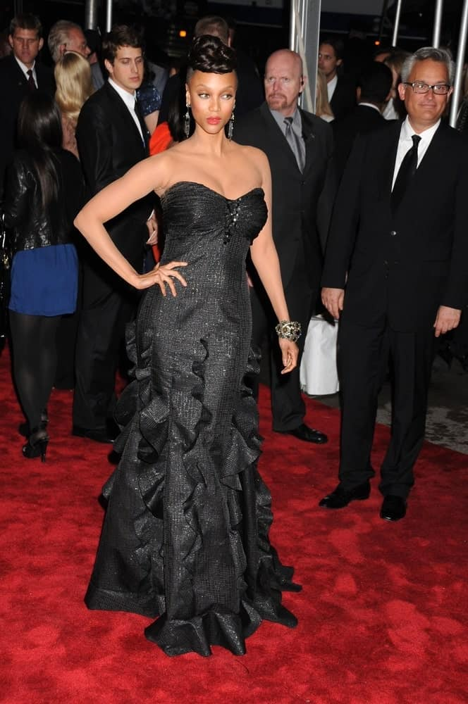 Tyra Banks wore a beautiful black Badgley Mischka dress at the Metropolitan Museum of Art event in New York on May 4, 2009. It went quite nicely with her raven top knot upstyle.
