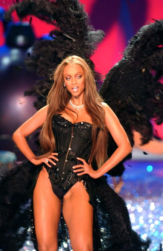 Tyra Banks walked the runway of the 2010 Victoria's Secret Fashion Show at the Lexington Armory in New York City. She was confident in her black costume and long, layered hair that is loose and tousled.